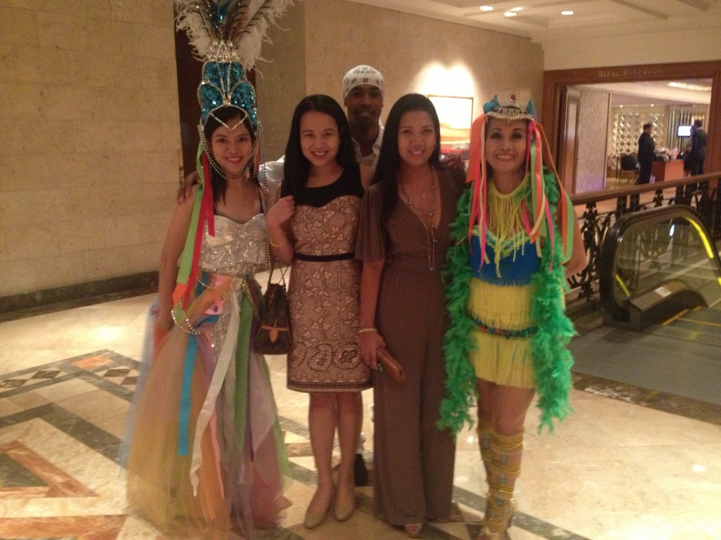 (Me and D with some Samba dancers in their uber colorful costumes!)